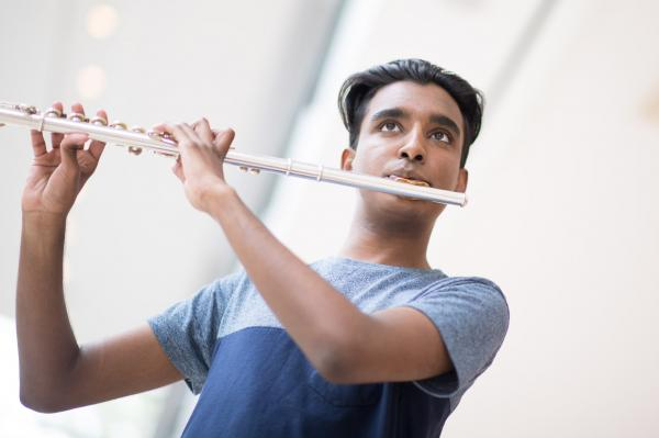 Benefits of the Program - young man playing the flute