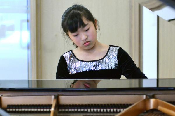 Admissions - student at piano