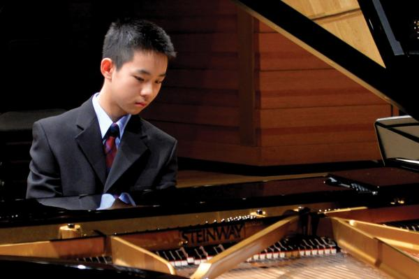For Current Students - student at piano