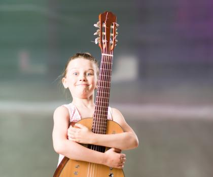 Girl with Guitar - Support your child's success in music study