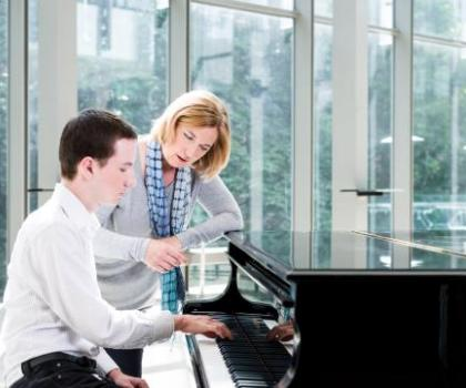 advanced student and teacher learning at the piano