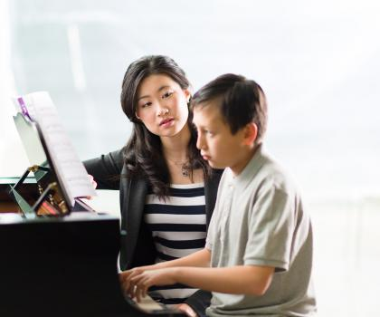 Teacher and student at piano - Piano Teacher Courses
