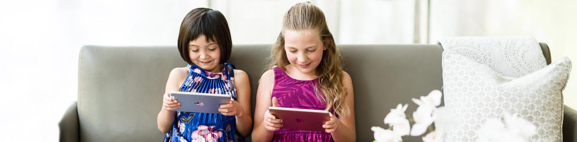 Two children learning music on a tablet