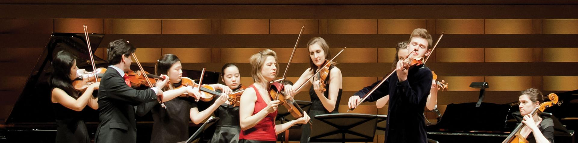 Donate Now - students performing in Koerner Hall