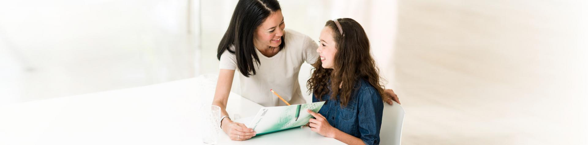 Testimonials - mother and daughter with theory book